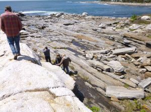 Carefully walking on the rocks in the lighthouse park
