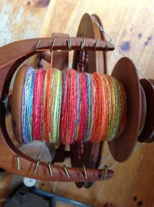 A bobbin full of the Blue Faced Leicester/Silk blend.  Love the colors!