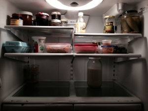Half gallon milk all alone on its shelf on the bottom.  Essentials are all that are left!