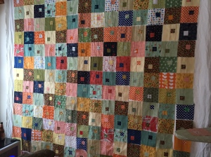 Flannel wall of quilt squares. Figuring out the patterns of color